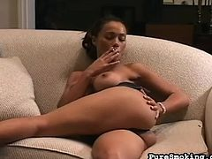 Hot smoking babe loves fingering her clit and masturbating like a true slut