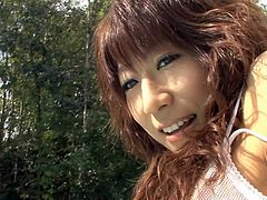 Steamy Japanese hoe Asuka Ishihara gives blowjob and foot job to hard cock