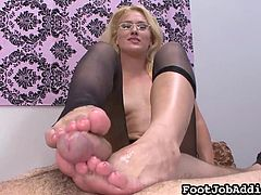 Naughty blonde likes sliding her sexy feet over this cock and stroke it properly