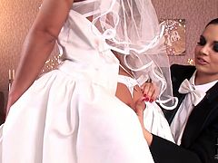 These jaw-dropping lesbians with nice round tits know how to make their wedding night more exciting and pleasurable. Playing lesbian groom with a strap on, this mouth-watering brunette lets her bride suck her fake dick.