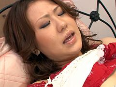 Hot blooded Japanese amateur in red lingerie and fishnet stockings gets her big milky tits stroked by kinky dude before he rubs her shaved cunt and later eats it with pleasure in steamy sex vdieo by Jav HD.