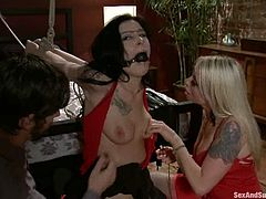 John Henry is having fun with sexy blonde Lorelei Lee and her cute dark-haired friend. He ties the girls up and destroys their holes in all known positions.