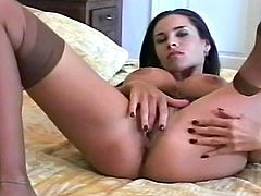 Brunette babe with big tits enjoys warm pleasure during her sexy masturbation solo