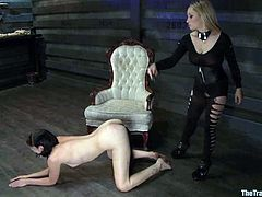 Brunette girl gets bonded by blonde chick. Aiden fixes pumps to Coral's boobs and then fingers her pussy.