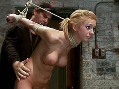 Gorgeous blondie gets suspended with a spreader bar on