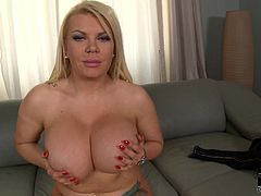 Busty blonde pronstar with huge tits enjoys bouncing them and teasing during solo