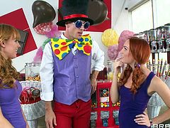 These two redhead girls are excited to see a joker. He brought a gift, but first they have to make some naughty moves, which will give the joker guy a boner. Soon enough he reveals his huge man meat right under his pants. Сuties grab his throbbing pole and suck it up and down all over.