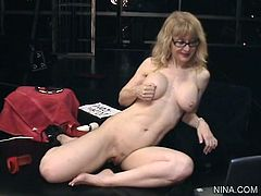 Nina Hartley is horny and eager to drill her wet cunt in amazing solo masturbation