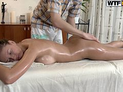 Dude knows his job well! He rubs oil all over her patient's tits and pussy pushing her to the edge of orgasm. She spices things up with a blowjob that makes him more horny than ever and then she lets him fuck her in missionary position.