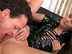 Young slender brunette Sweet Lana with dark heavy make up and slim body in provocative black latex outfit gives lusty blowjob to tall tattooed stud and gets licked to orgasm.