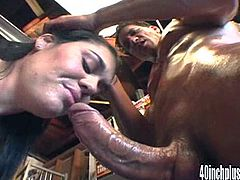 Take a look at this brutal hardcore scene where a slutty brunette has her huge ass oiled up before sucking and fucking a thick cock.