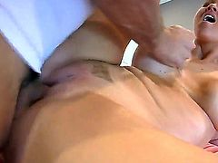 Young looking hots ass babe Abbey Brooks with big fake hooters and pretty smile has arousing full body massage in living room action with handsome stud on a lazy afternoon.