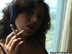 Horny babe with big tits smokes while teasing with her sexy black lingerie