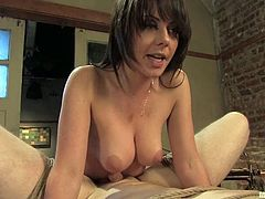 See the hot dominant MILF Penny Flame having fun with a guy, torturing his nipples, tying him up and even fucking him with a strapon.