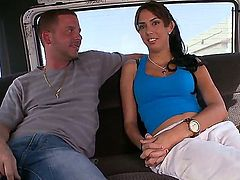 Young amateur brunette babe Karina with nice natural boobs and pretty face in white pants and blue t-shirt has interview filmed in the car on a hot summer day.