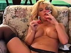 Blonde milf in sexy lingerie likes masturbating her tight pussy while smoking like sluts