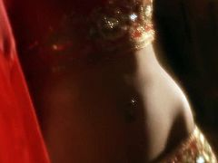 She is indescribably beautiful Indian girl. She has got svelte tempting body wrapped with red silk fabric. She takes off the robe demonstrating her beauty in all the glory.