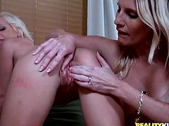 Damn hot and sexy MILFs are going kinky in a steamy lesbian sex video produced by Reality Kings. One of them fingers fucks another so the latter quivers with pleasure. Then she facesits her lover getting wet snatch eaten dry.