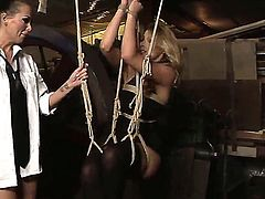 Mandy Bright ties up this sexual and very beautiful busty girl Cindy Hope by thick ropes making her almost absolutely unmovable from it before starting to give punishment.