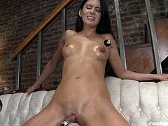 Superb brunette chick sits on the stairs getting her pussy toyed by the fucking machine. Then she also fingers and toys her vagina with a vibrator.
