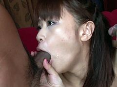 Steamy Japanese milf inclines to give thorough blowjob to strain dick of horny dude before another fucker joins them to make her suck two cocks simultaneously in MMF sex clip by Jav HD.
