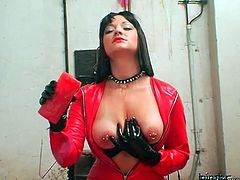 Mistress in red leather pours hot wax on him