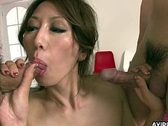 Hot japanese plases two cocks with her sexy mouth and that tight hairy pussy