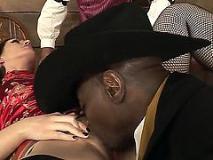 Arousing brunette Sarah Shevon with heavy make up and round bouncing bums in fishnet stockings gets rammed by black bull Sean Michaels in front of Bob E in kinky fantasy.