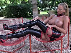Bodacious dominantrix babe chills out on the fresh air showing off her big perky tits. She also flaunts her logs legs in those gorgeous latex stockings.