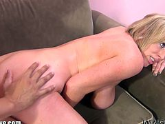 Naughty busty chick Maggie Green is having fun on the couch. She spreads her legs and gives up her pussy for some hardcore pounding!