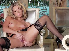 Beautiful blonde Sarah Peachez in black nylon stockings shows off her small boobs and firm ass she she masturbates her shaved pussy. She finger fucks her snatch with desire in solo action.