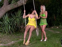 Awesome babes are outdoors in their colorful lingerie. Sexy brunette on the swing turns her ass for a blondie and she fingers her cunt.