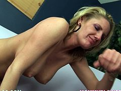 Take a look at this blonde milf's sensational body in this hot POV clip where she sucks on a big fat cock on camera.