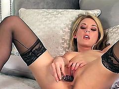 Michele Monroe with tiny boobs and hairless twat howls as she plays with herself