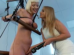 Cherry Torn and Lea Lexis are playing dirty games. Lea puts Cherry into irons and attaches wires to her body before pressing her nice tits.