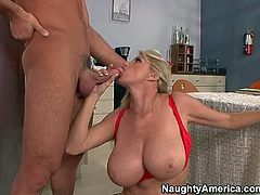 Heavy chested golden haired momma in sexy red lingerie enjoys in giving head and getting pounded pretty hard and rough on the bed by Charles Dera and enjoys in hot sex