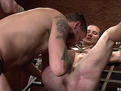 Press play on this hot gay bondage video where one of these guys is tied up while the other plays with his hard cock and fucks him bareback up the ass.
