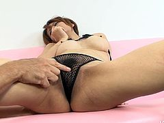 Arousing Japanese babe in fishnet panties moans with pleasure while a kinky bald dude drills her brownish shaved vagina with his fingers in missionary and doggy styles.