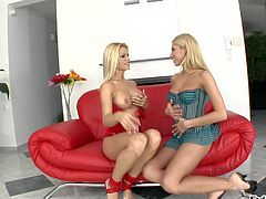 Busty and arousing blonde babe Clara G enjoys in playing with her shaved beaver on the sofa until her horny blonde girl comes and joins in for a hot session
