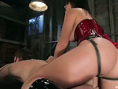It's a femdom video where Penny Flame, who is wearing a very sexy latex outfit, is going to tie and strapon fuck a dude in the dungeon.
