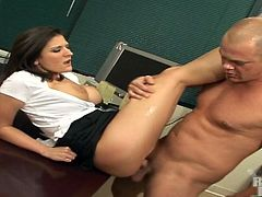 Austin Kincaid is getting naughty in an office. The brunette lets the man play with her tits and then they fuck ardently in cowgirl position on a chair.