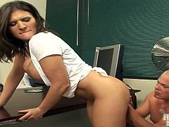 Sexy brunette gets her tits licked and her vag smashed in an office