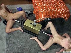 Ashli Orion and Callie Carter strip their clothes off and lie down on the floor. They spread their sexy legs and get their tight pussies drilled by fucking machines.