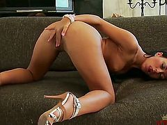 Young hot ass brunette hottie Bailey Ryder with long sexy legs and pink slutty nails in high heels only poses and polishes her shaved wet cunny to orgasm in living room.