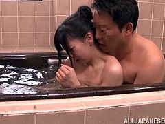 This guy is having a sweet and inexperienced Japanese teen that agrees to satisfies his sexual desires. He's in the bathtub with her and plays with those sweet titties and her hairy pussy. Having enough with the playing the guy fingers and licks her vagina before he stands up and puts her to suck his cock