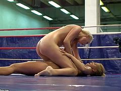 These hot and arousing blonde babes Linda and Teena enjoy in their passionate and pretty arousing nude wrestling session in the ring in the gym and get caught on cam with pleasure