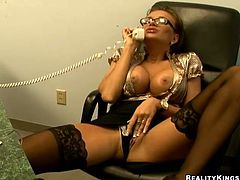 Horny secretary talks by the phone and masturbates right in the office. Then she gets fucked hard and deep by her colleague.