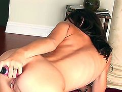 Sandy Sweet shows her private parts in solo anal action
