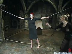 Lewd redhead milf ana Dearmond lets some girl bind and torment her in a cellar. Then she gets drowned and enjoys having a toy in her cunt.