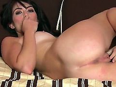 Ashlyn Rae with small breasts and clean bush has fire in her eyes as she plays with herself